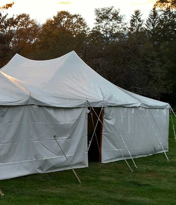 Shield guests from rain, wind, and sun with canvas tent sides